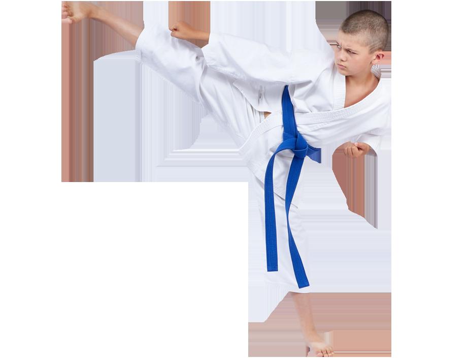 Boy karate kicking