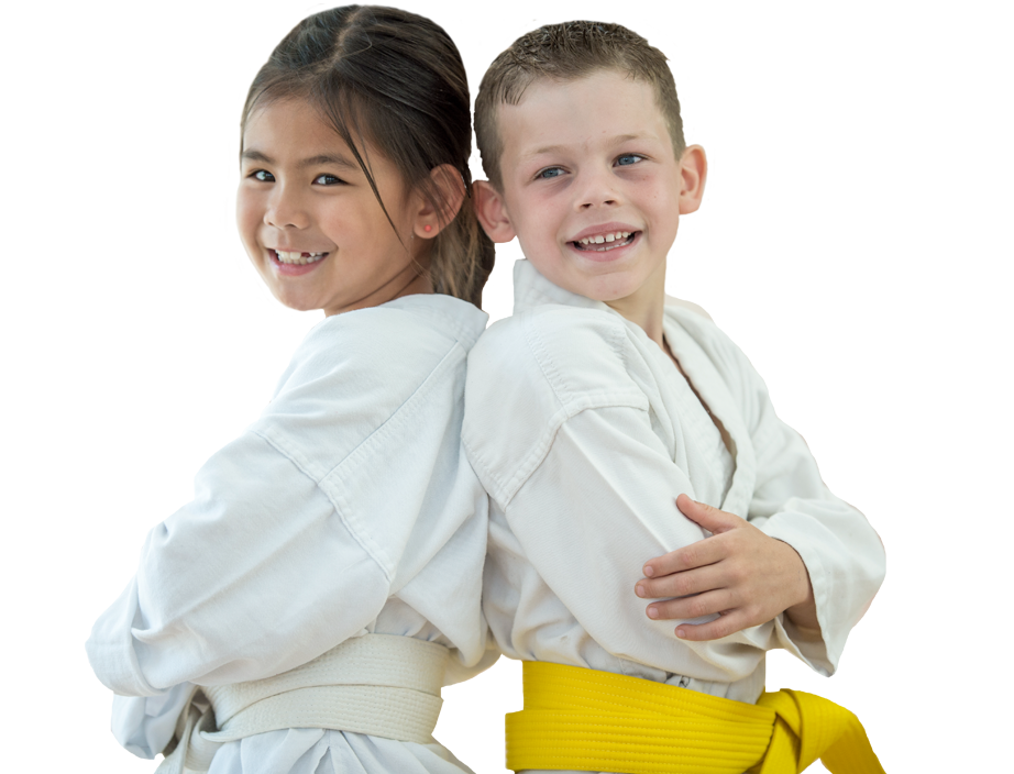 young girl and boy in karate uniforms
