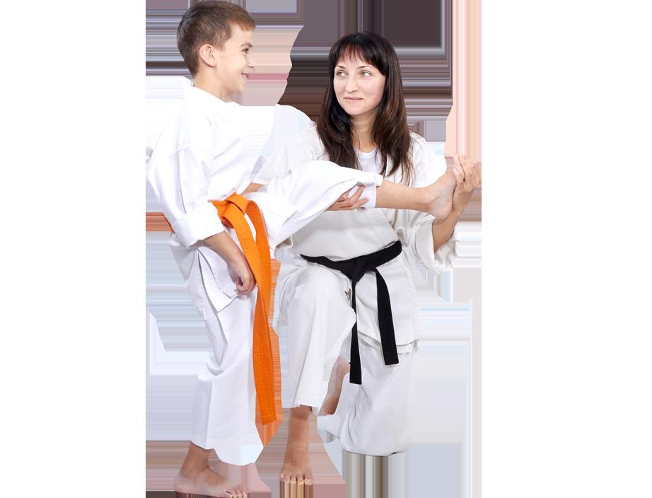 instructor teaching boy how to kick