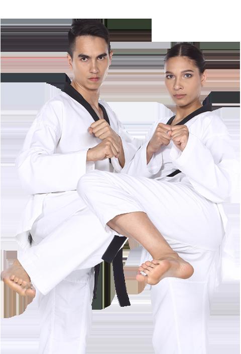 a man and a woman karate kicking